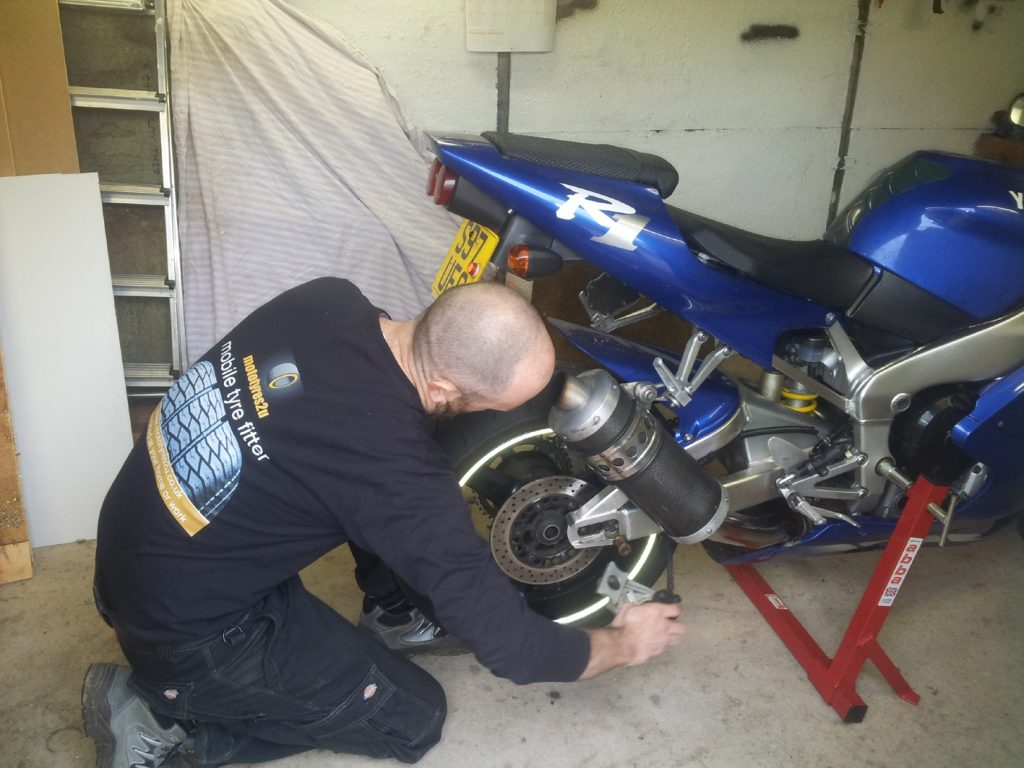Mototyres 2 u fitting replacement new motorcycle tyres using motorbike stand. Wheel removal.
